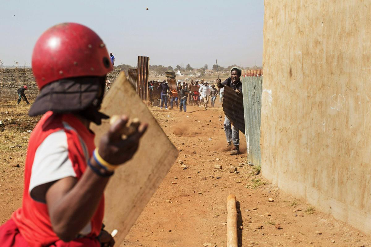 22 September 2017. Close quarters fighting between the Red Ants and land occupiers in Univille, south of Johannesburg.