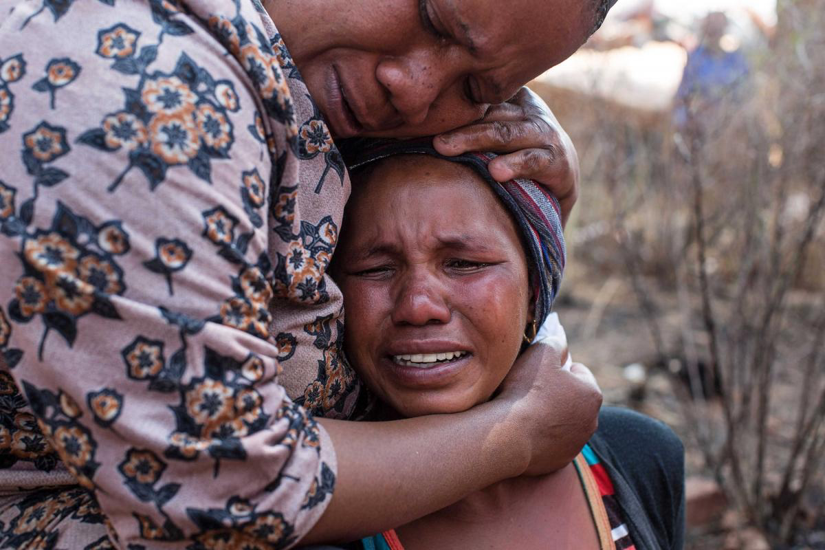 22 September 2017. Nokulunga Mbangi cries after being told that her husband Isaac Mofali had been killed by the Red Ants. He was (allegedly) beaten to death with crowbars. She is comforted here by her sister-in-law Sophie Mofali.