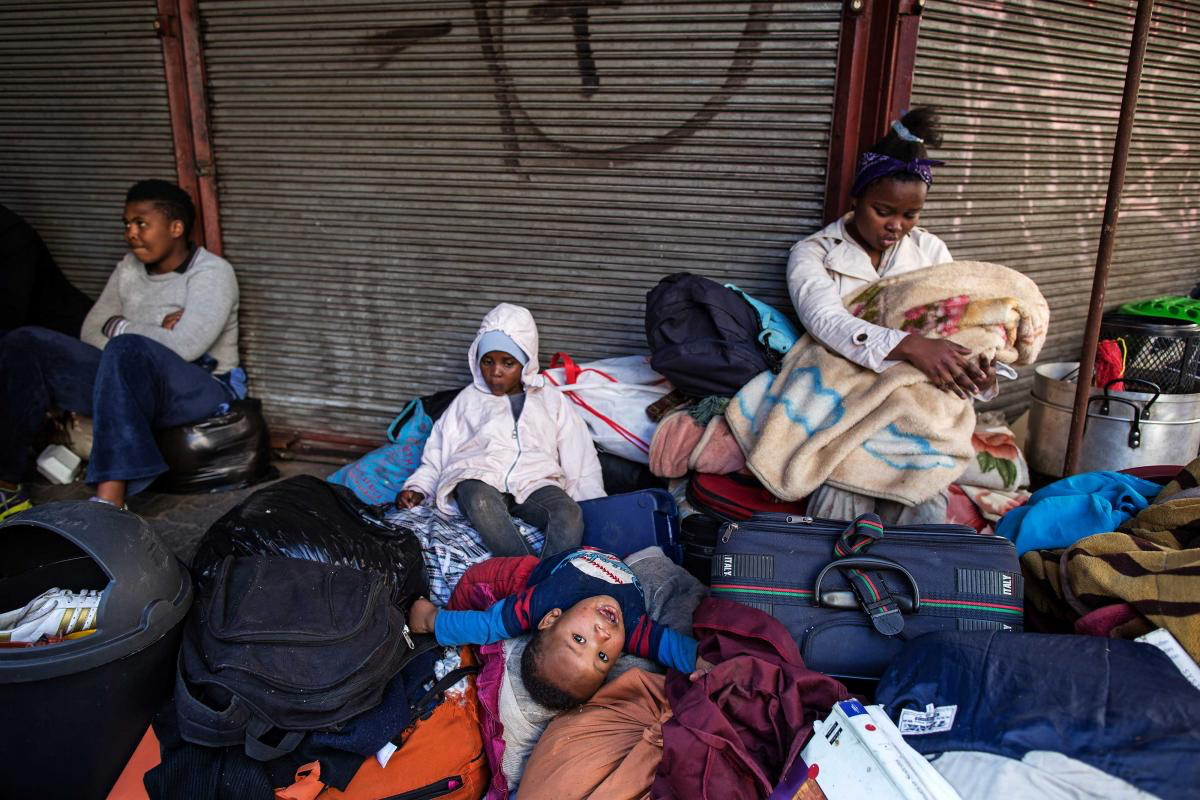 19 July 2017: Evicted residents of a 10-storey hijacked building called Fatti's Mansions spent several nights sleeping outside on Jeppe Street in the Johannesburg CBD.