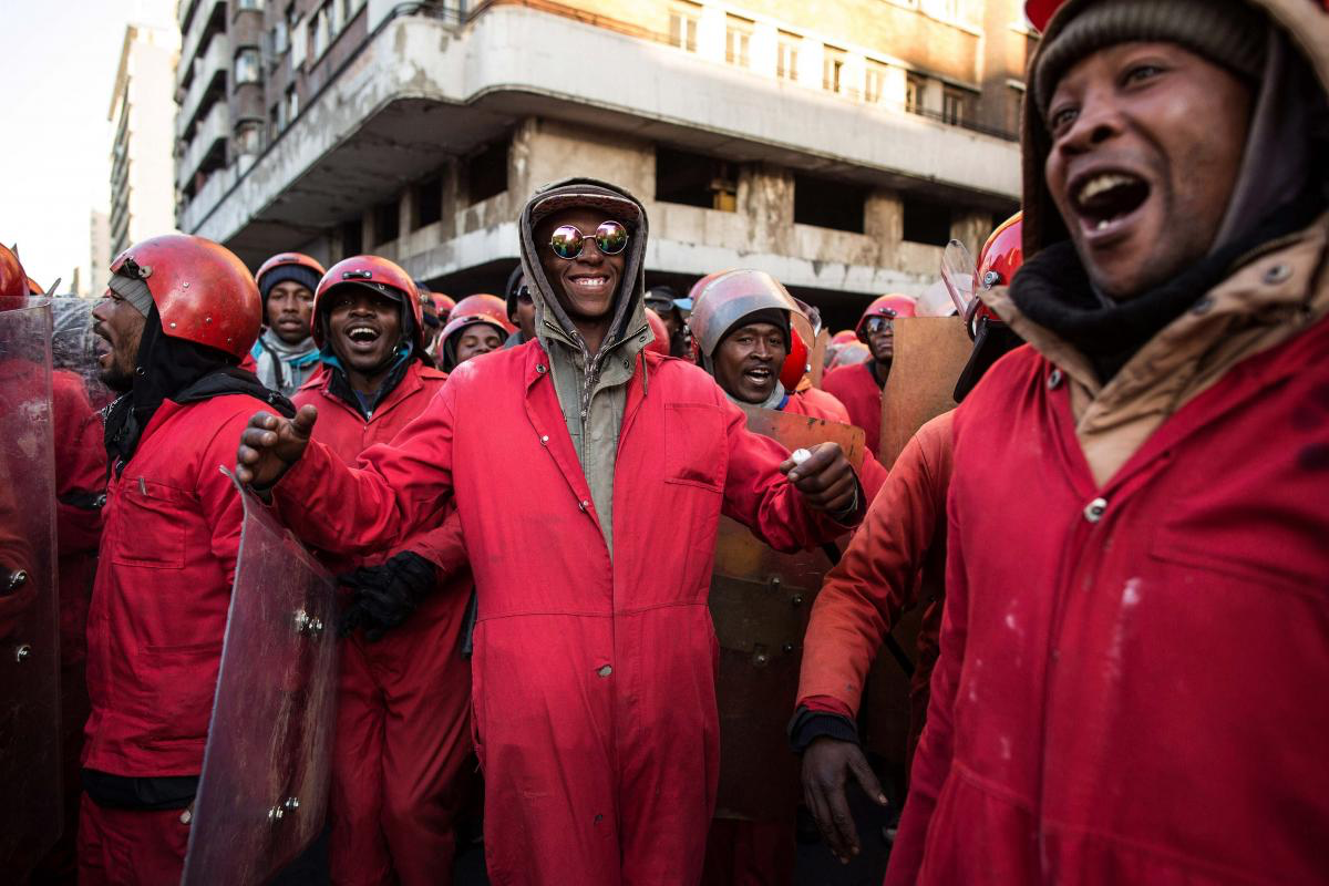 19 July 2017. The Red Ants sing and cheer after finishing the eviction of Fatti's Mansions.